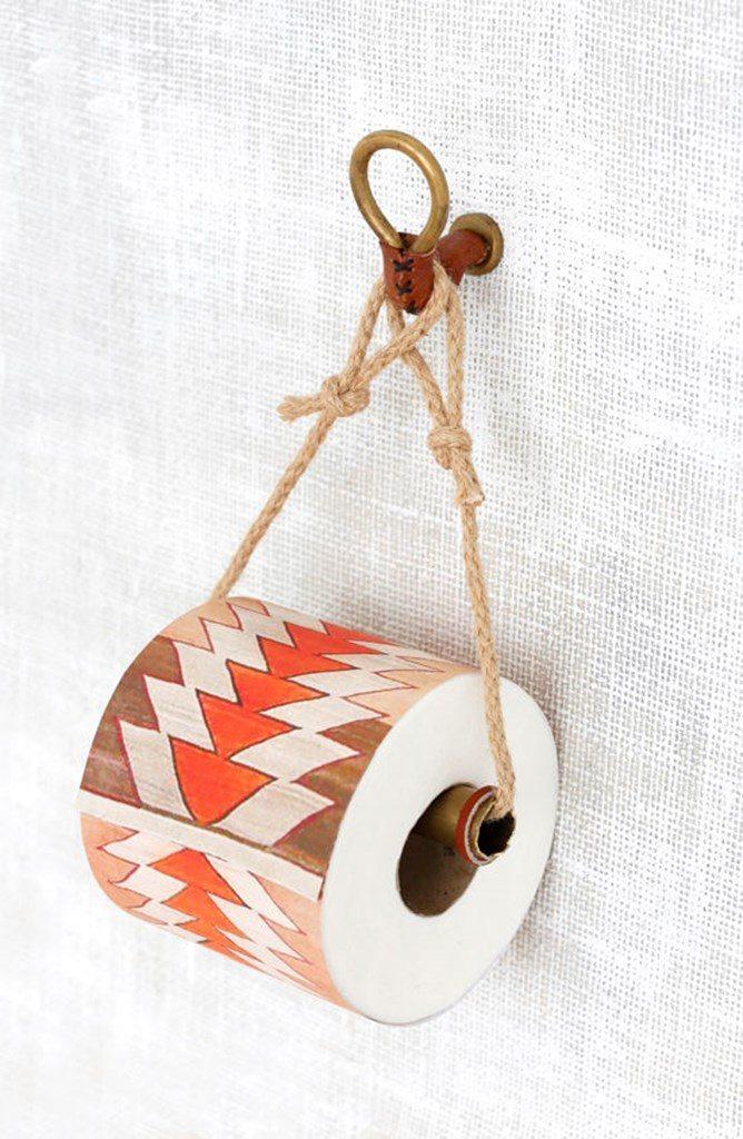 15 totally unusual diy toilet paper holders homelovr for Diy toilet paper storage