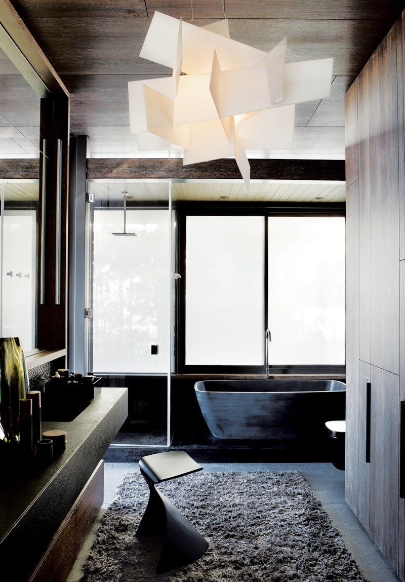 Dark Bathroom with Sculptural Light Fixture