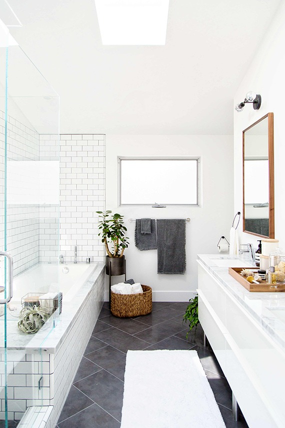 modern bathroom design with subway tiles glass door
