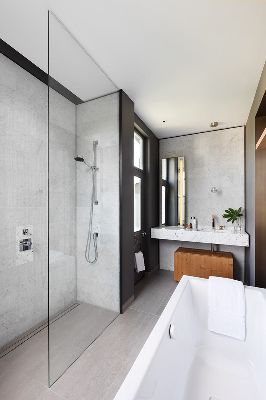 Modern Bathroom with Marble, Black and Wooden Accents