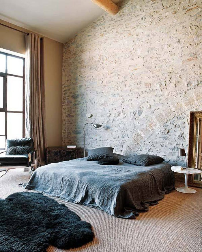 minimalists bedroom with exposed brick wall