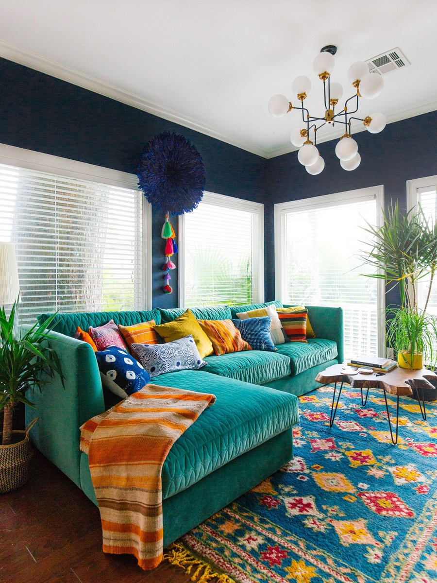 Green Sofa And Colorful Rug