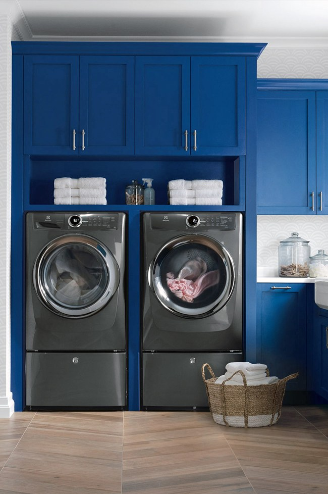 Laundry Room with Bold Blue Cabinetry