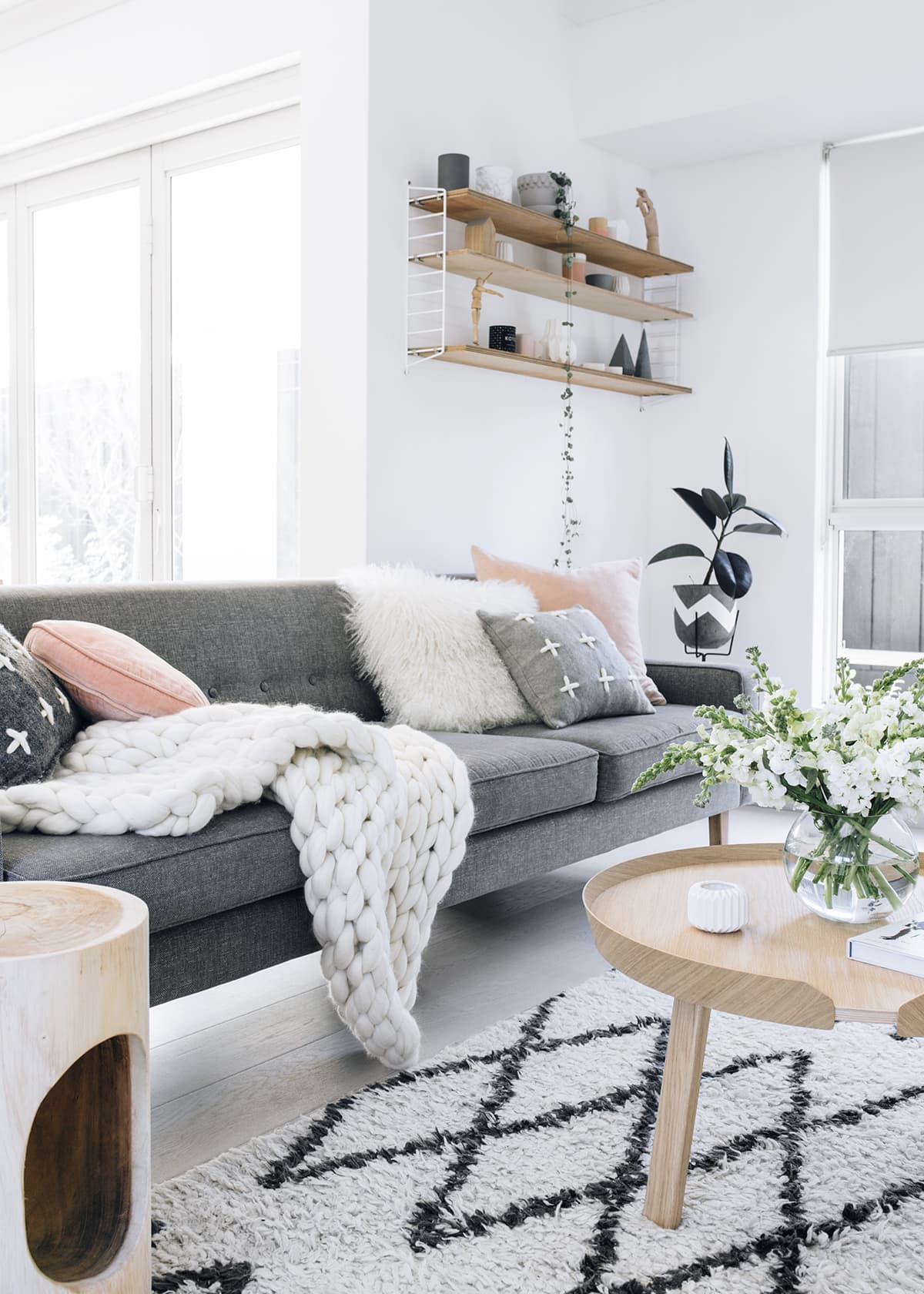 Grey Sofa and White Chunky Knit Throw