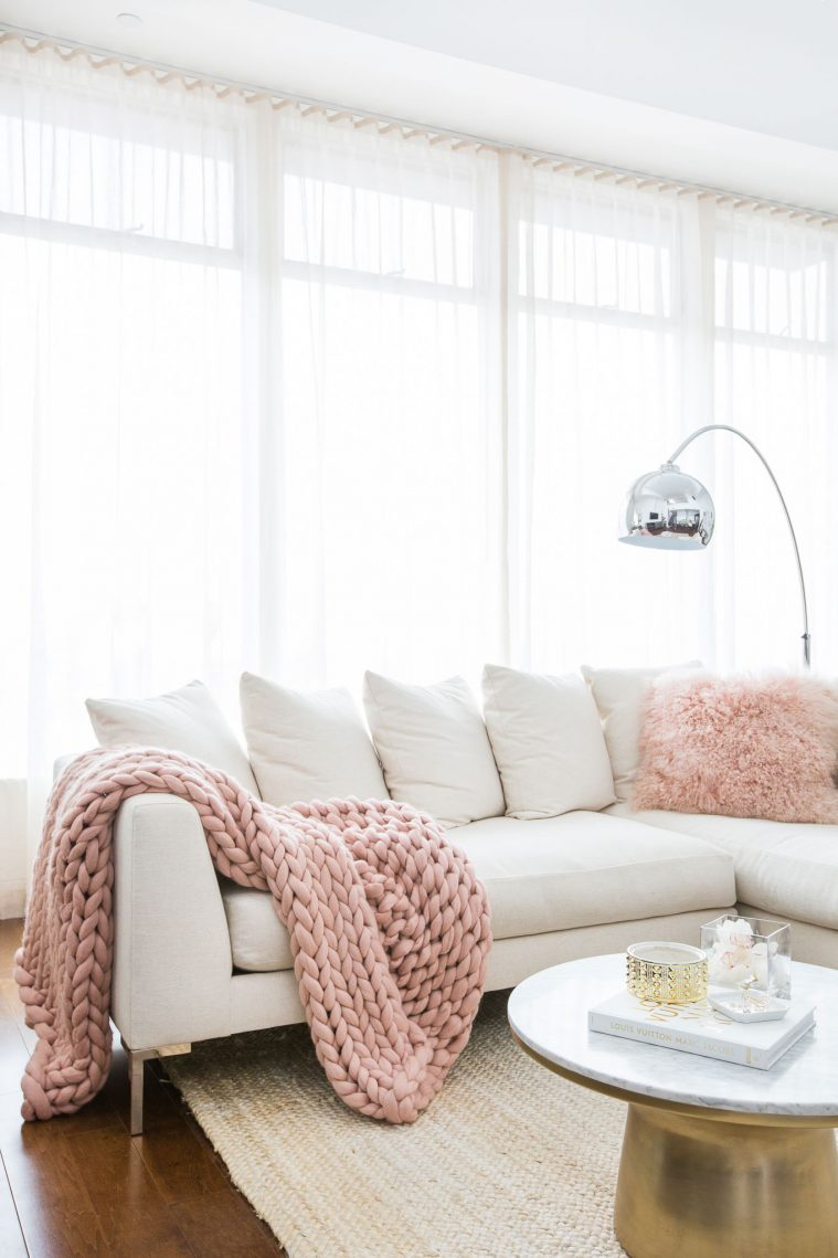 Neutral Couch and Pink Chunky Knit Blanket
