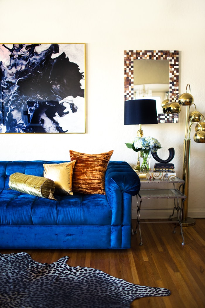 Bold Blue Velvet Sofa Paired with Gold and Animal-print Accents