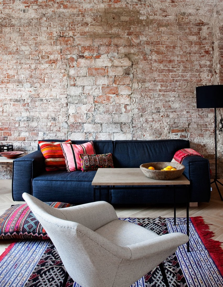 Velvet Blue Sofa & Brick Wall