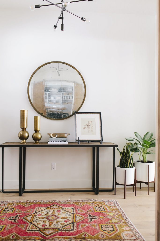 Entryway console table and rounded mirror
