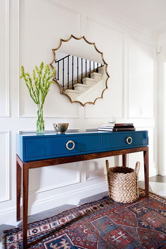 Modern entry with mid-century style table in blue lacquer