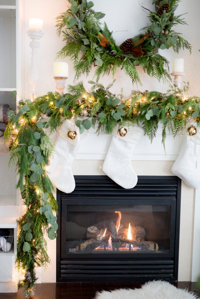 Real Garland and White Stockings Christmas Mantel​
