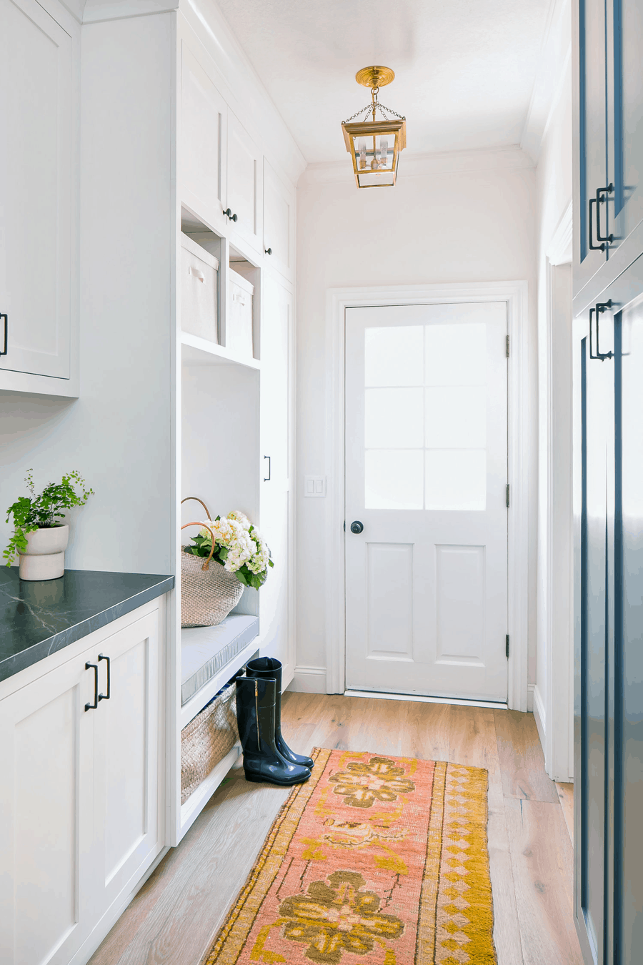 Neutral Mudroom With Colorful Rug